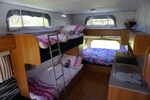 sids-bunk-beds-queen-bed-and-kitchen